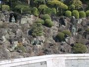 Statues and donations wall, Naritasan Shinshoji Temple, Narita, Chiba-ken, Japan, photo
