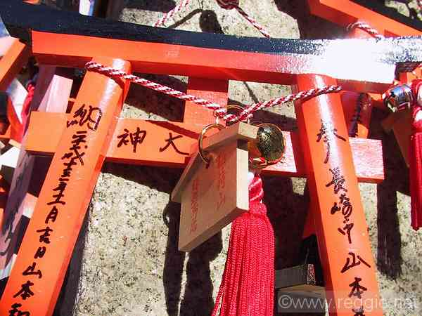 Torii prayers, Fushimi-inari shrine, Kyoto, Japan, photo