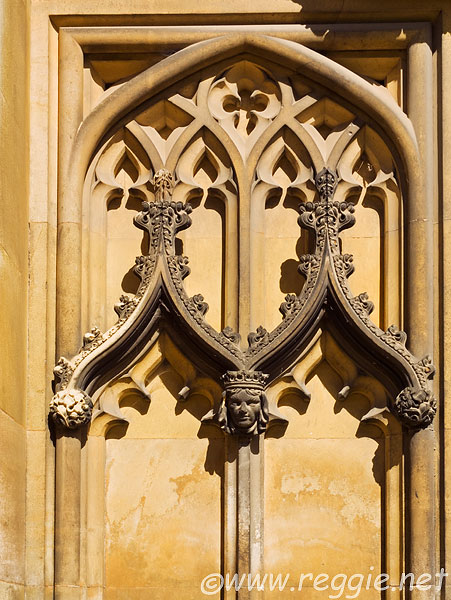 Crowned head, decoration around gothic-style archway, New Court, St. John's College, Cambridge, England