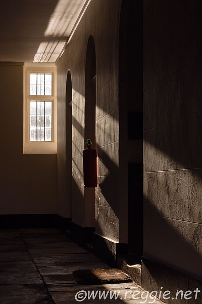 The fire extinguisher and light through the window, Third court, St. John's College, Cambridge, England