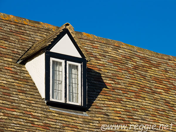 Tiled roof and attic window on Tudor house High Street Hemingford Abbots Cambridgeshire : window in attic  - Aeropaca.Org