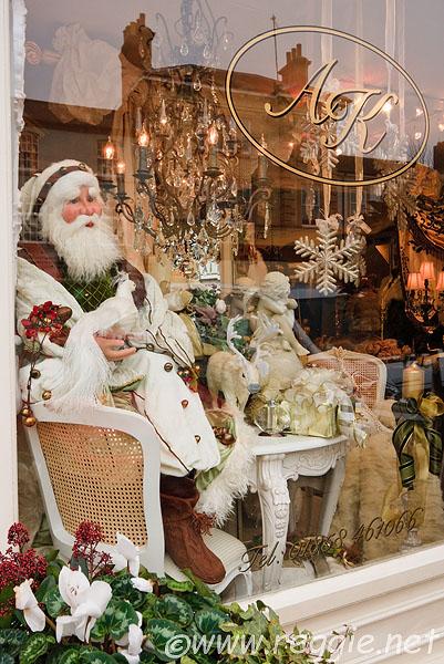 Santa Claus Christmas decorations in shop window