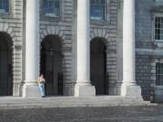 Student by chapel, Trinity College, Dublin, Ireland, photo