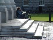 Sitting by public theatre, Trinity College, Dublin, Ireland, photo