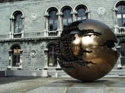 "Arnaldo Pomodoro sculpture ""Sphere with Sphere"" by museum, Trinity College, Dublin, Ireland, photo"