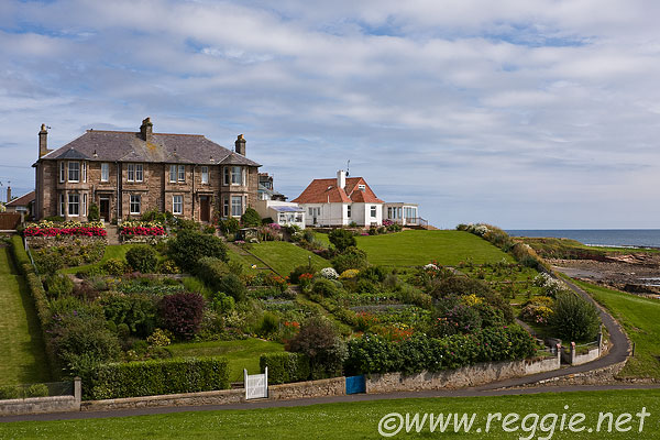 House with large gardens by seaside, Crail, Fife, Scotland